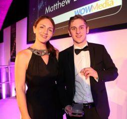 Matt Lovett winning an award for WOW Media